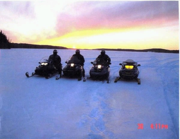 Click image for larger version  Name:snowmobile on lake 2.jpg Views:85 Size:44.6 KB ID:10035