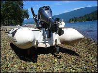 Click image for larger version  Name:boat_launching_wheels_quick_release_installed_to_transom_of_inflatable_boat.jpg Views:45 Size:180.9 KB ID:127730