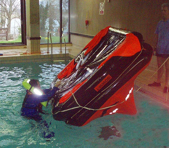 Click image for larger version  Name:righting liferaft.jpg Views:142 Size:93.9 KB ID:38170