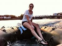 Steph piloting the boat.
