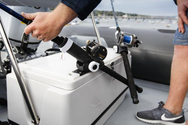 Multi-purpose rear bench. Live bait well & rod holders with detachable cushion