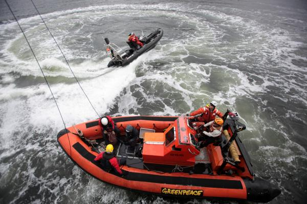 "The Parker rib on swell generation duty as climbers train for boarding ""things"" at sea."
