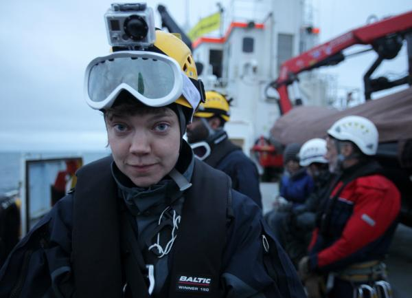 Sini looking pensive. All wired up and ready to defend her Native Arctic heritage ....by rib of course
