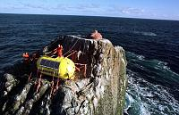 Thumbs up after having installed the survival capsule on the rock (1997)