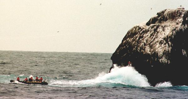 Climbing Rockall from a Greenpeace rib in 1998