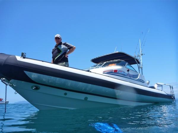 A proud owner in pristine summer waters, off Coromandel coast, New Zealand, January 2011