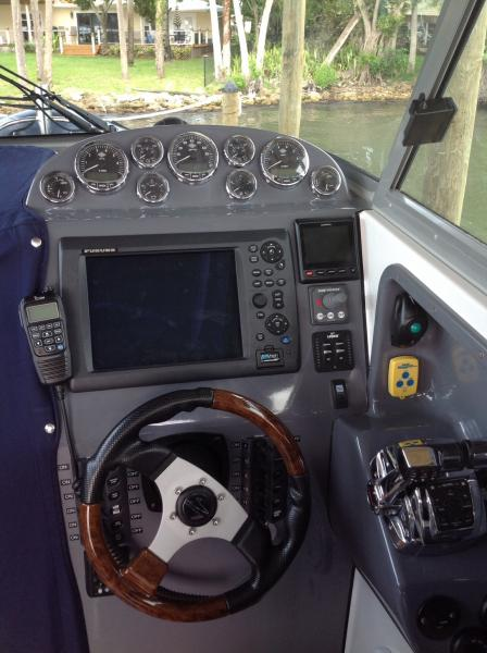 Helm station.  Garmin GHP 20 autopilot with Shadowdrive and Verado Smartpump system providing full integration with Furuno electronics and Mercury Verado engines.  Garmin permits operation of autopilot from anywhere on vessel.