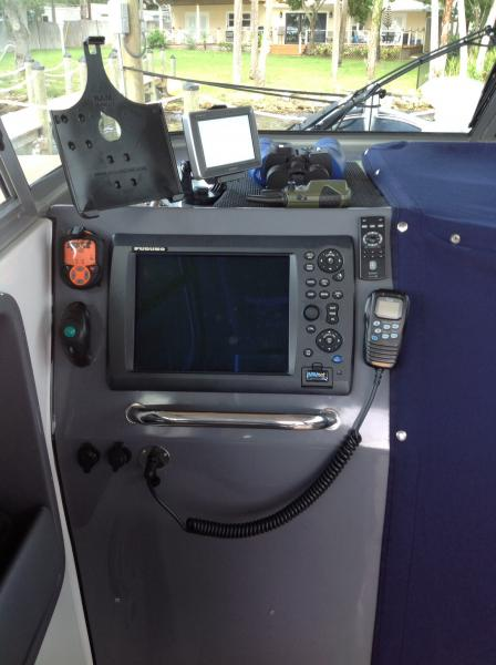 Navigator's station.  Note Command mic, SPOT transmitter, and finger mouse to remotely control Furuno NavNet 3D system.