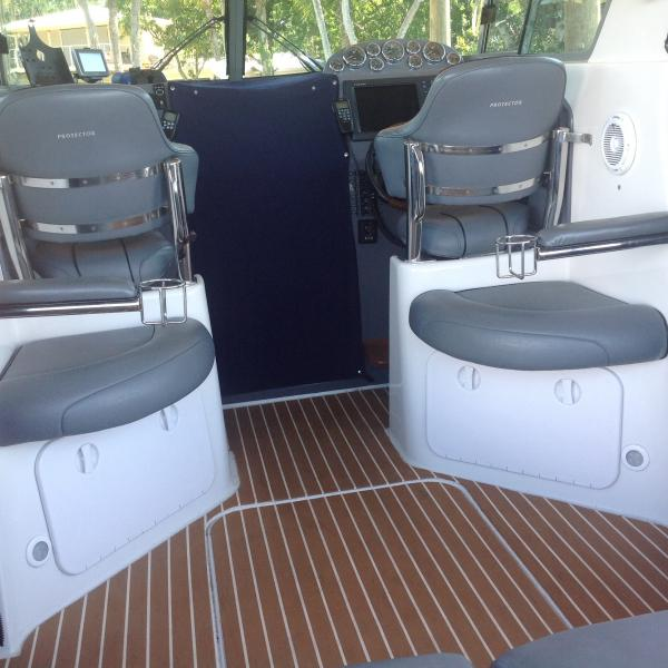 Rear facing seating with custom arm braces