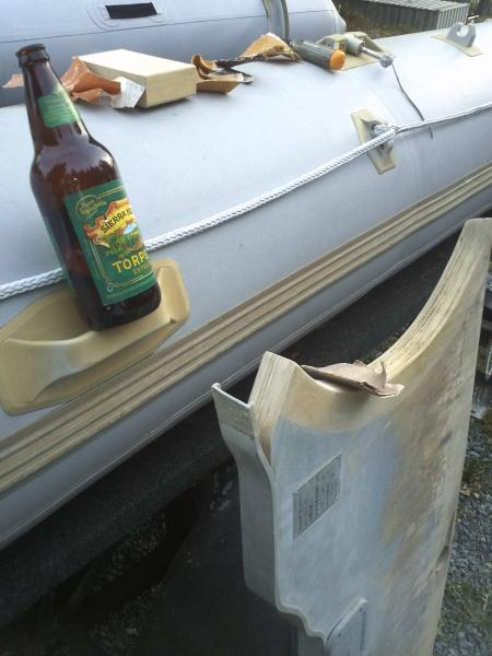 A beer goes a long way when sanding a now dry transom.