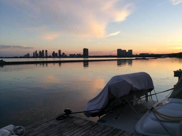 Sunset with dinghy on the swim platform davits at home dock in Toronto, Canada.