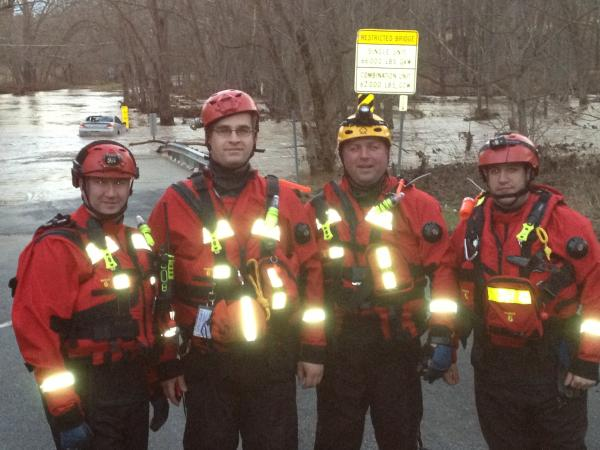 Strike Team-740 after successfully rescuing a person from the car being swept downstream. Car is in the background.