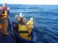 Taking on Chas from St Davids lifeboat for run back to Milford Haven (photo credit St Davids RNLI)