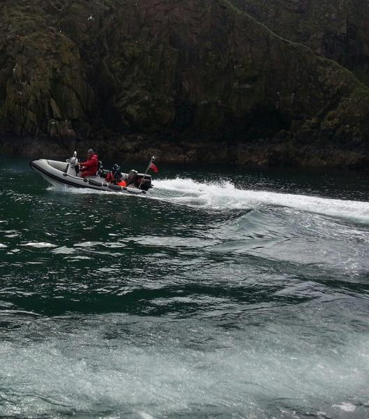 Testing the trouble-some Tohatsu in a sheltered cove in the Bullers of Buchan.