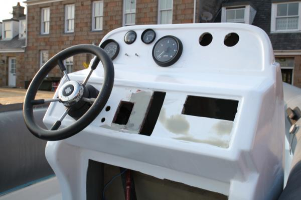 Fitted steering wheel and gauges