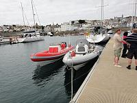 Into the Red next to Grimalkin (Avocet) on Guernsey, with Paul Cannell stood on the pontoon