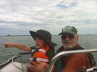 My son Finn and his Grandpa George on Lake Huron