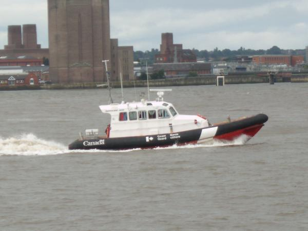 Beam shot of the RIB 'ENERGY' passing the Mersey tunnel air vent on the Birkenhead river.