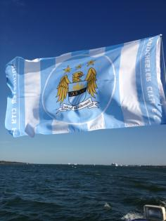 City flag flying high over the Solent. Champions after too many years